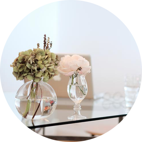 Flowers on table in glass vase interior design North Shore Auckland